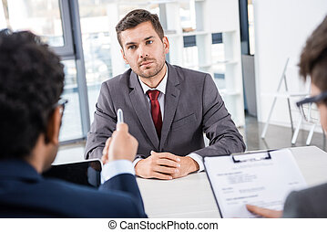 attentive businessman listening to colleagues during job interview, business concept