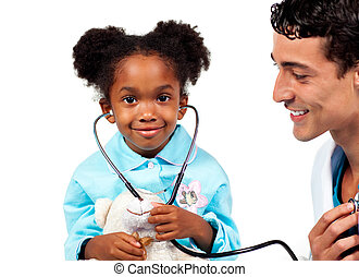 Attentive doctor playing with his patient against a white ...
