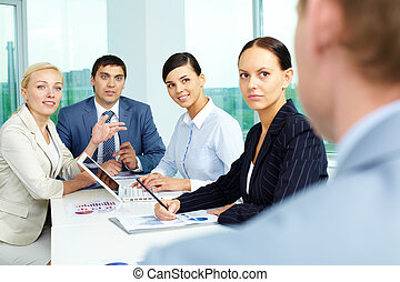 Attentive employees - Group of business people looking at...