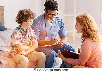 Attentive family doctor writing down the prescription