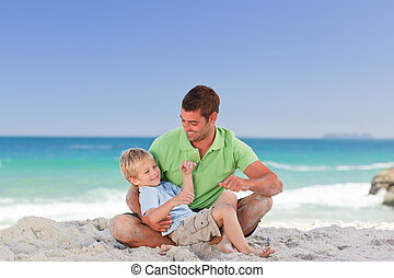 Attentive father with his son at the beach