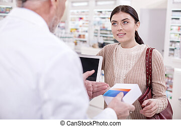Attentive female client asking for information