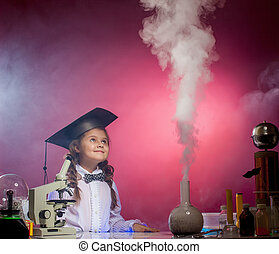 Attentive girl watches evaporation of reagents - Attentive...