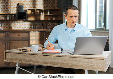Attentive male person working at home