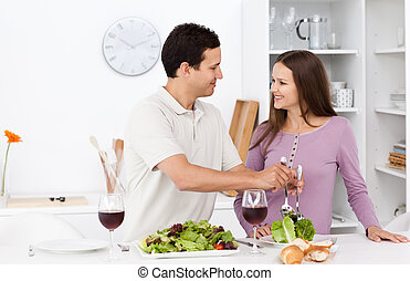 Attentive man serving salad to his girlfriend
