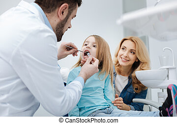 Attentive mom brining her child to the dentist