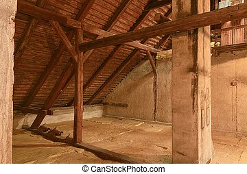 Attic loft insulation. Old loft. renovation and thermal insulation with mineral rock wool.