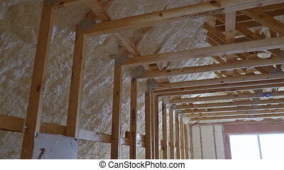 Attic with foam insulation of heating system on the roof of ...