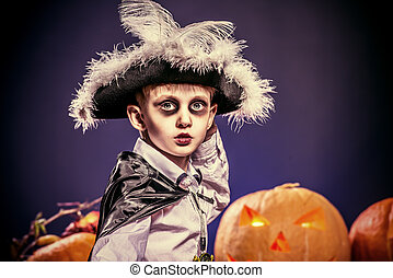 attire boy - Little boy in halloween costume of pirate...