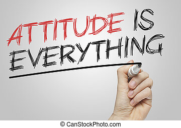 Attitude is Everything written on a board with a red and black marker