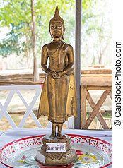 Attitude or Posture of the old golden Buddha in Thai Temple