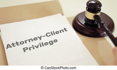 Attorney Client Privilege written on legal documents with gavel