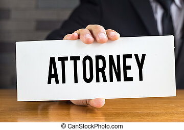 Attorney, message on white card and hold by businessman