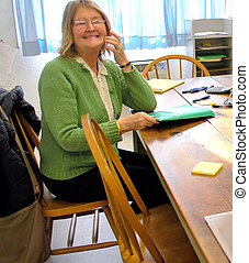 Attorney - Female attorney in her office working on a case.
