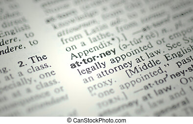 The word attorney from the dictionary displaying a very shallow depth of field