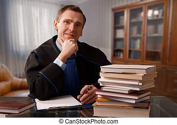Attorney wearing classic gown in his office
