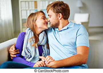Attraction - Amorous young couple having rest at home
