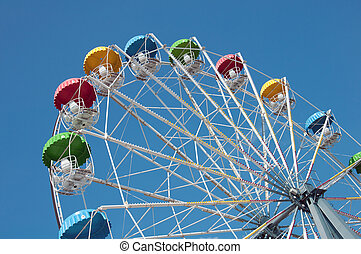 "Attraction ""Ferris Wheel"" on a background of blue sky"
