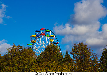 Attraction Ferris wheel on blue sky background