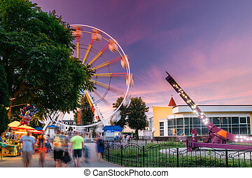 Attraction Ferris Wheel On Summer Evening In City Amusement Park