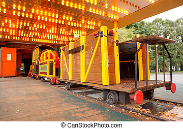 Attraction in park. Children\'s railway, train with bright cars.