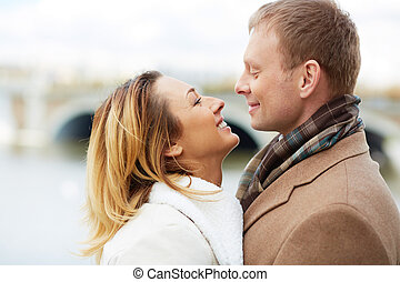 Attraction - Portrait of affectionate couple looking at one ...