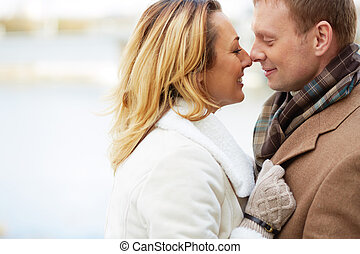 Attraction - Portrait of happy and affectionate couple