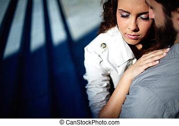 Attraction - Portrait of affectionate female embracing her...