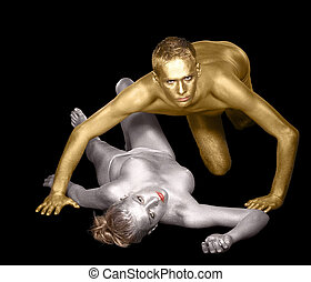 attraction - studio shot of a silver bodypainted woman and...