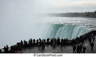 Silhouettes of people crowds watching Niagara falls powerful beauty
