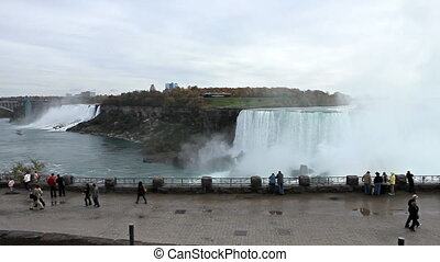 Visitors enjoying powerful beauty of Niagara Falls