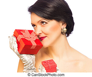 Attractive adult woman holding red present