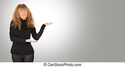attractive adult woman pointing to ad space