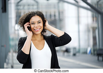 Attractive african american business woman smiling with cellphone