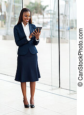 african american businesswoman working on tablet computer