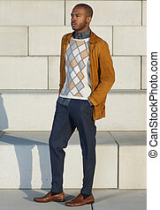 Attractive african american male model standing outdoors