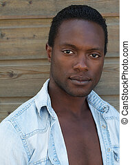 Attractive african american man looking at camera