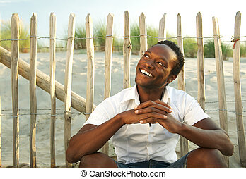 Attractive african american man smiling outdoors