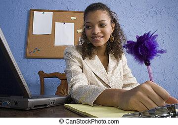 Attractive African American Teen Girl at Desk