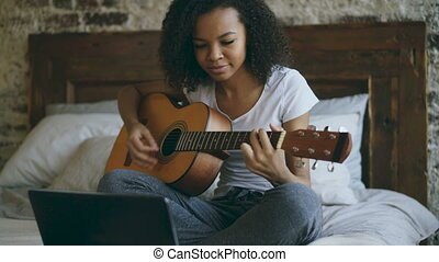 Attractive african american teenager girl concentraing...