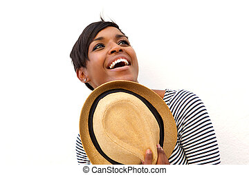Attractive african american woman holding hat
