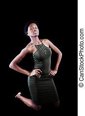 Attractive African American Woman Kneeling In Green Dress