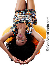 Attractive African American Woman Laying On Stool