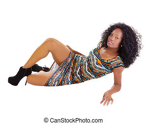 Attractive African American Woman Reclining In Dress