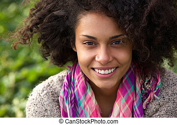 Attractive african american woman smiling outdoors
