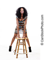Attractive African American Woman Standing Hands On Stool