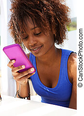 Attractive african american woman using mobile phone - Close...