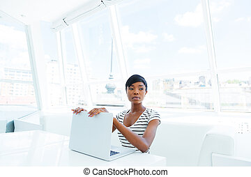 Attractive african american young woman accountant working in office