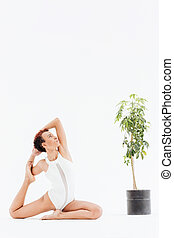 Attractive african american young woman doing stretching yoga exercises