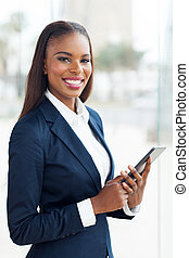 african business executive working on tablet pc